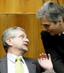Austrian Vice Chancellor Molterer talks to Infrastructure Minister Faymann during a session of the Parliament in Vienna